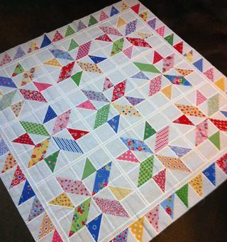 Great scrap quilt with Pam Kitty Morning fabric (Miss Rosie)
