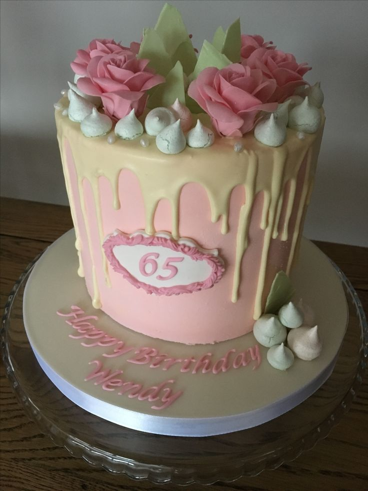Drippy cake with pink sugarpaste roses and pastel green decorations