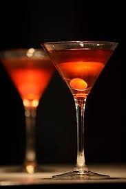 THE MANHATTAN COCKTAIL   2 ounces Wild Turkey Rye bourbon whiskey 1 ounce sweet vermouth 1/2 oz Grand Marnier Orange Liquer    2 to 3 dashes aromatic Angostura Bitters  Maraschino cherry,   for garnish , Orange peel, for garnish  SHAKE Pour into glass placing orange peel and cherry in glass and serve