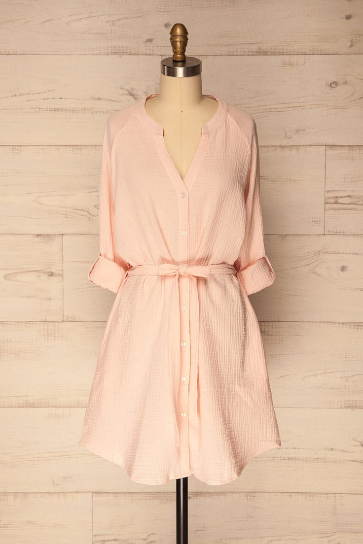Valtoi Pink #boutique1861 / Dress in style with ease and comfort in this fabulous shirt dress! The cotton material is textured, stretchable, and incredibly soft. It features buttons down the front, two lateral pockets, and long sleeves that can be fastened at a 3/4 length. Show off your waist by tying up the matching fabric belt, or switch it out for one of your own. Throw it over your swimsuit as a cover-up or pair it with sandals for a day out!