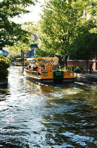 Enjoy an evening water taxi cruise along the Bricktown Canal in downtown Oklahoma City's Bricktown Entertainment District.