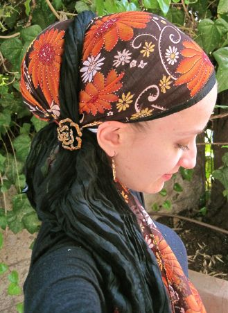 Andrea Grinsburg, : I took a long, black scarf and tied it with one end hanging…