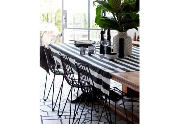 """Real Living: Massproductions """"Tio"""" chairs in Black, $420 each, Spence & Lyda.   ON TABLE Edit """"Stripes"""" fabric from $160 a m, Orson & Blake."""