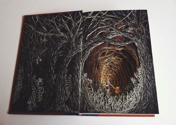 Book sculpture of Christopher Robin and Winnie the Pooh inside forest