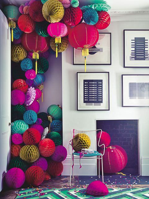 Fill a corner with colourful paper lanterns... More really is more! Image: Livingetc
