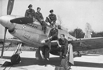 Late in 1945, the unit's code letter were changed from RF to PD. Shown here is  PD-D, KM112 of S/Ldr Drobinski at RAF Coltishall late 1945. Leaning on a wheel is W/O Bargielowski, DFM and ace status. On the wing W/O R. Falkowski. (from Polish Squadrons Remembered)