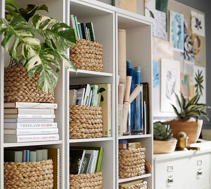 Bookcases filled with baskets | Decorating a bookcase