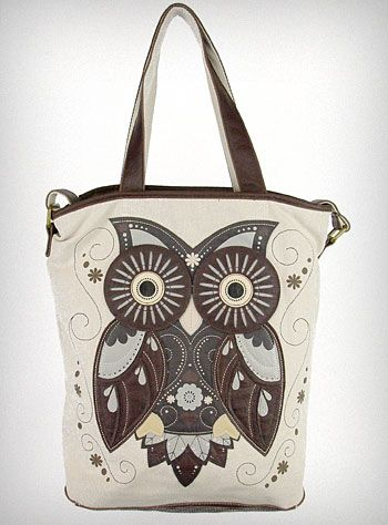 """Crafty Owl Tote Bag  This large tote bag, from Loungefly, features a natural canvas body embellished with a large brown and slate blue faux leather Crafty Owl applique, and brown faux leather trim, handles, and shoulder strap. The interior has one large main compartment with a small zippered pocket, a cell phone pocket.  * 15"""" x 14"""" x 5""""   * 8.5"""" Handle Drop  * Shoulder Strap adjusts to 21""""  * Canvas Body   * Vegan Friendly"""