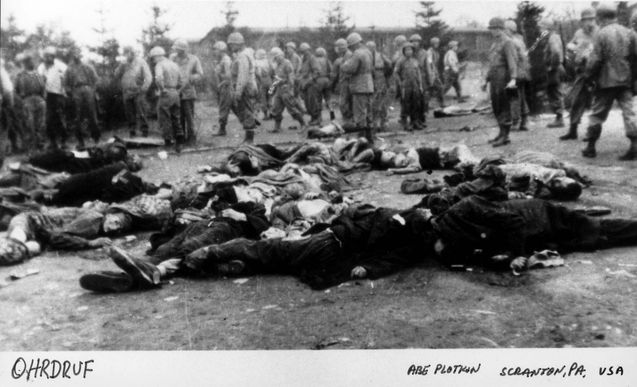 Ohrdruf, Germany, US soldiers next to corpses of prisoners, after the liberation, 1945.