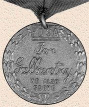 The Dickin Medal, often called the Animals' VC. The legend reads: FOR GALLANTRY and WE ALSO SERVE.