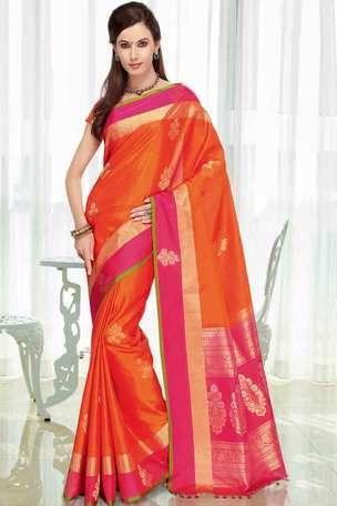 Orange silk zari weaved saree in pink zari weaved pallu & orange blouse