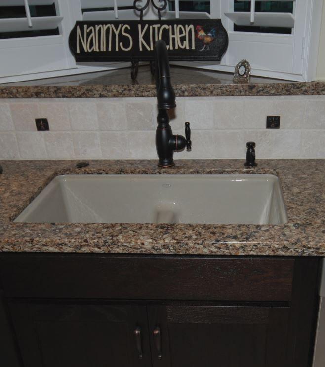 Kholer Vinnata faucet in oil rubbed bronze with Kohler Deefield Smart Divide sink in Sandbar in Cambria Canterbury countertop.