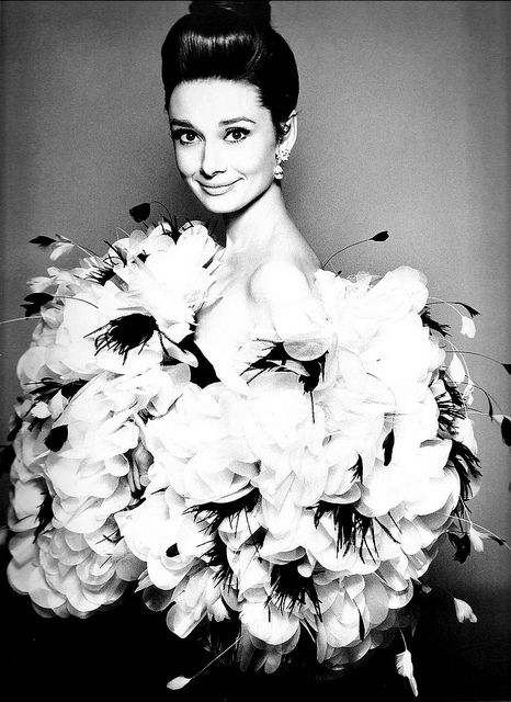 Audrey is wearing wonderful black silk dress worn with stole of white silk covered in white organza flowers with black/white feather plumes, photo by Avedon for Harper's Bazaar, Sept. 1962