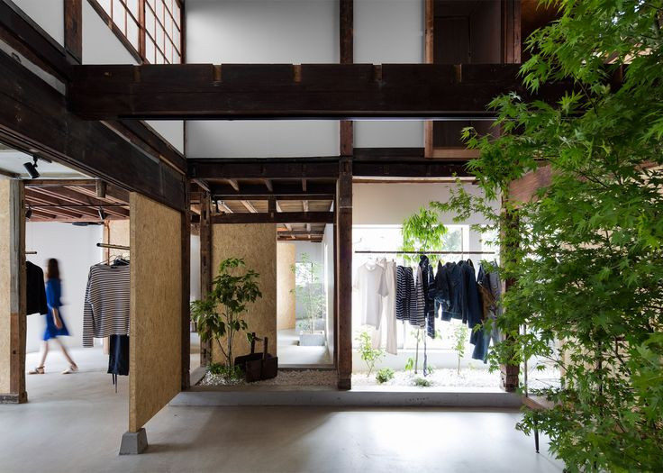 White-painted walls and plywood panels contrast with the existing wooden interior of this vintage clothing store in Saitama city