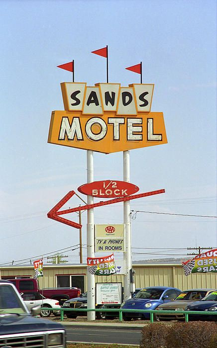 """Route 66. The Sands Motel in Grants, New Mexico, on Rt. 66 features """"TV and Phones in rooms."""" You just can't pass that up."""