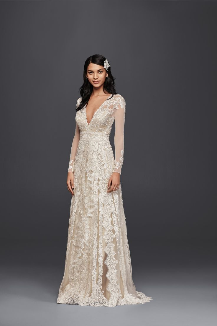 A lace sheath wedding dress with plunging neckline and lace long sleeves for your rustic nuptials. Shop this style by Melissa Sweet available at David's Bridal