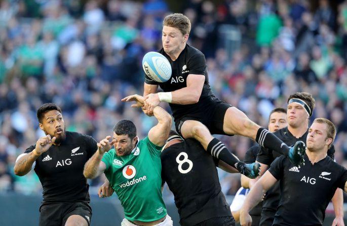 Ireland's Rob Kearney with Beauden Barrett and Kieran Read of New Zealand. Photo: Dan Sheridan/Inpho