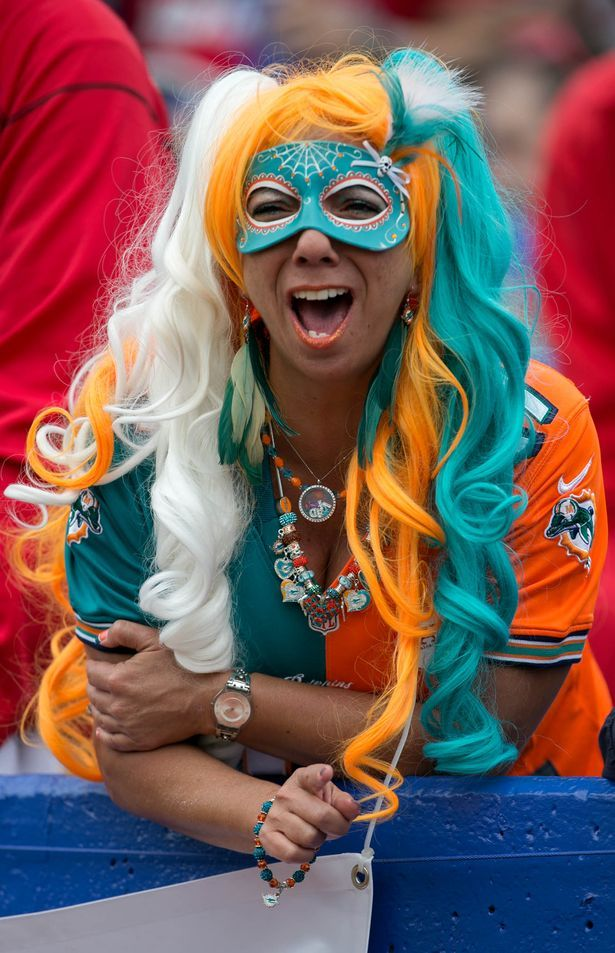 Dolphin Diva, Jen Schultz of Wellington, Fla., cheers for the Dolphins at Ralph Wilson Stadium in Orchard Park, N.Y., on Sept. 14, 2014. (Allen Eyestone/The Palm Beach Post)