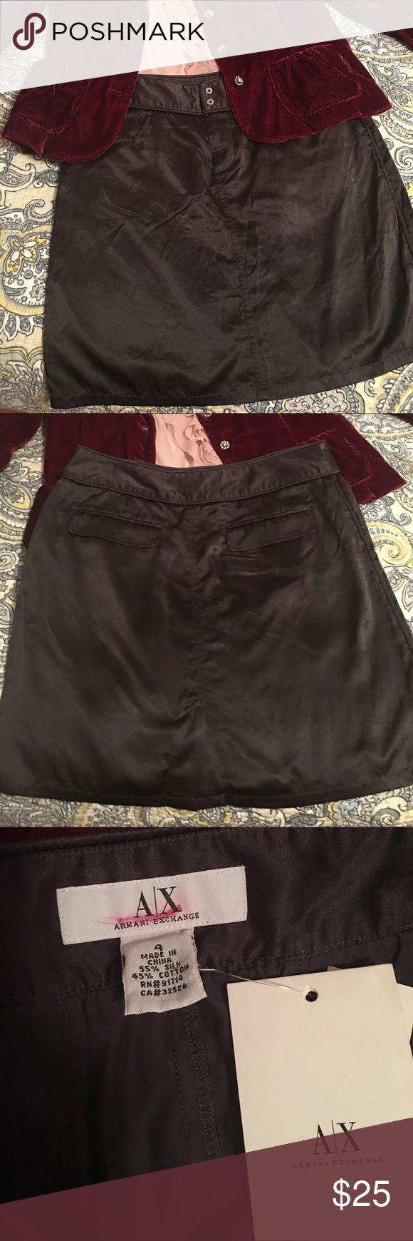 "Armani Exchange silk skirt Chocolate silky smooth skirt. Zip waist with two snaps, side and back pockets that lay flat. Back slit. Length is 18"" and waist is 14.5"" laying flat. Silk and cotton material. Hand wash or dry clean. A/X Armani Exchange Skirts Mini"