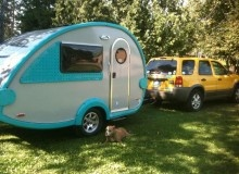 Sure wish my car could tow one of these!!  It's a T@B Caravan teardrop trailer!  You can even get a tent, or screened in family room that attaches to it!