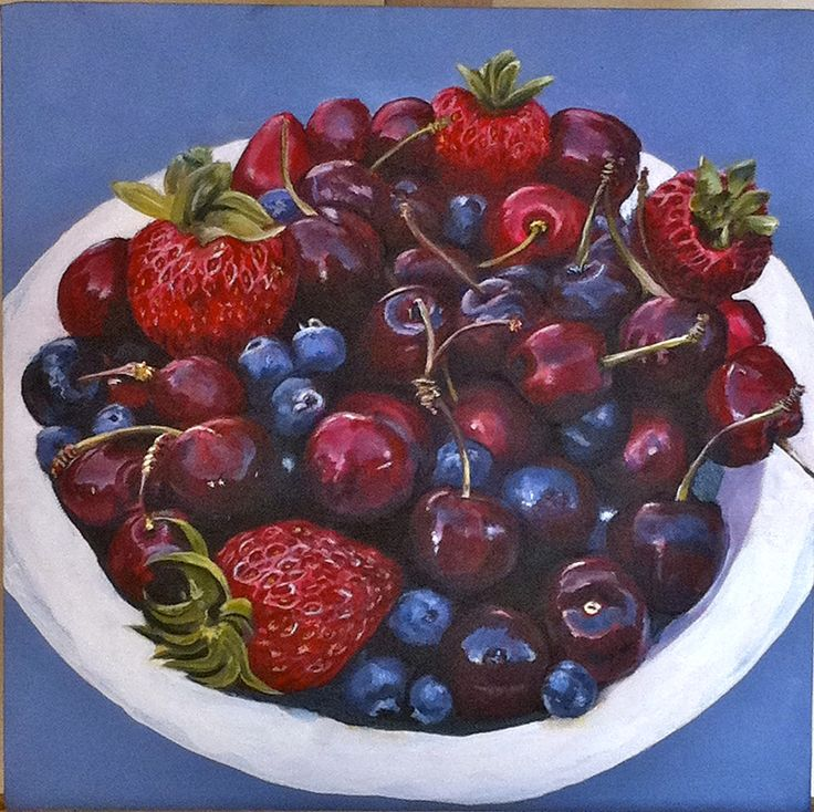 Still life of strawberries, blueberries and cherries in white bowl.