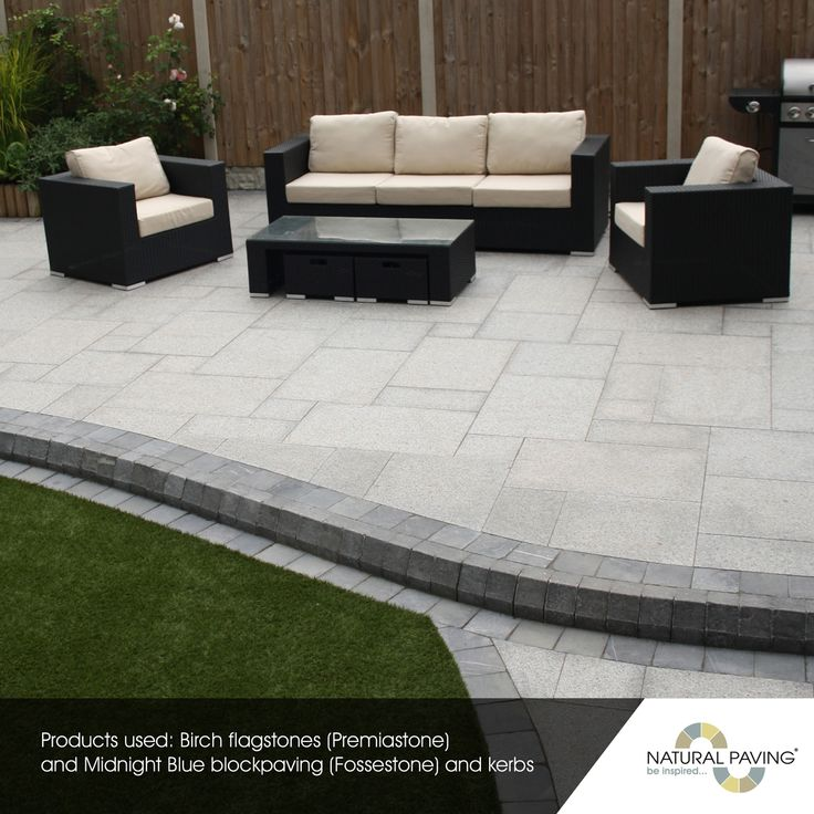 """The winner of """"Best Large Patio Design"""" in our Natural Paving Landscaping Awards 2016 is Tony Ward of Award Landscape! Award Landscapes created a large paved area, providing an outside lounge area and path down to a separate seating area. Not only this but they also created a vegetation space! The use of our Midnight Blue block paving and edgings highlights the Birch granite, and defines the sections within the patio and garden. Landscaping 
