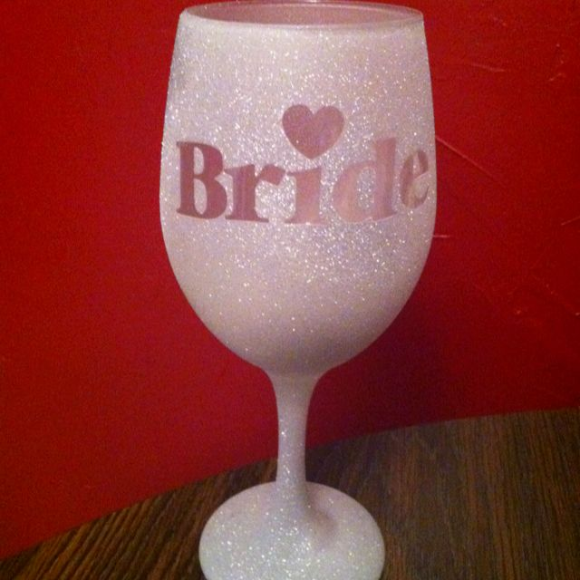$1 wine glass from dollar tree, frosted glass spray, glitter spray and stickers for the words! Easy and fun!