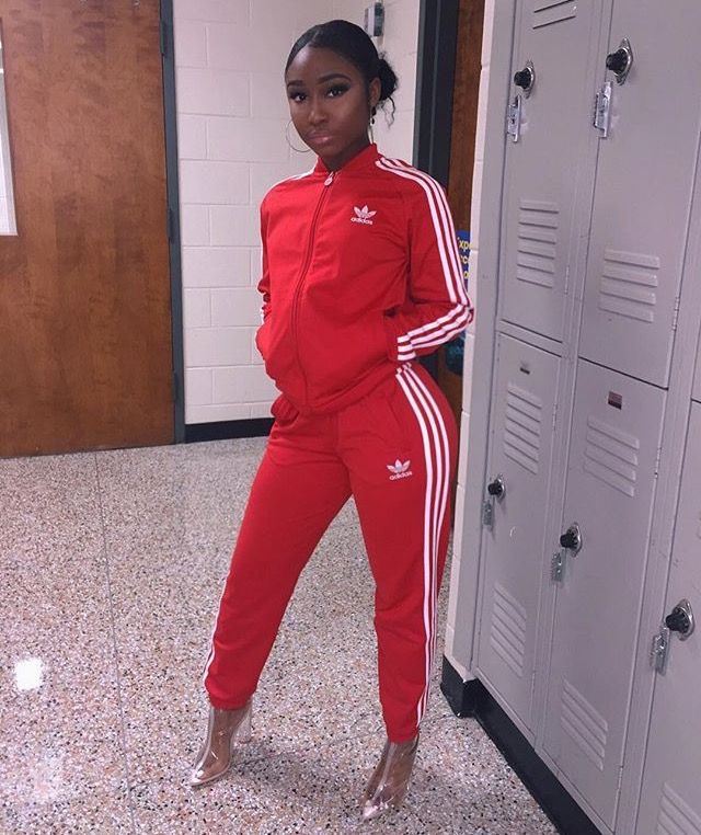 Esyonce. All red adidas track suit with clear plastic ankle boot heels