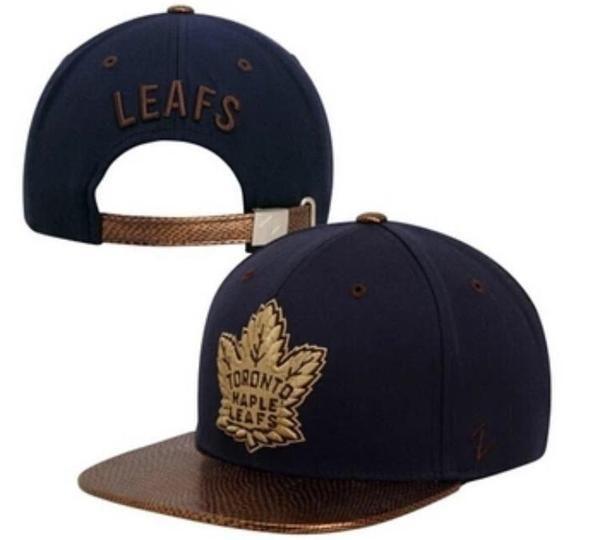 2813d004d Toronto Maple Leafs Snake Skin Visor SnapBack | Mens Accessories ...