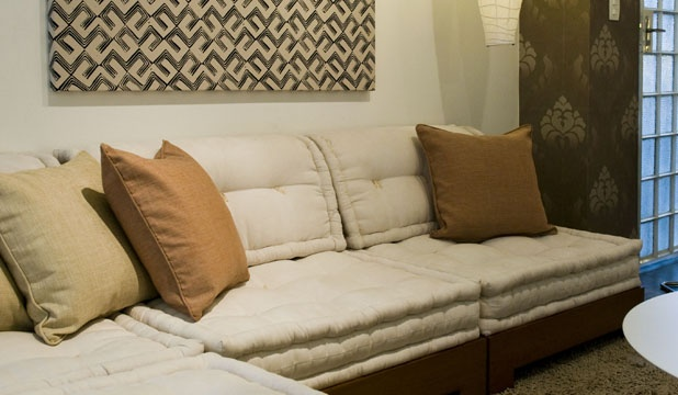 Sofa composed of Futon Cushions in neutral living room
