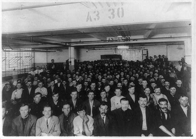 Immigrants in English class given by Training Service of the Department of Labor in Ford Motor Co. Factory, Detroit, Michigan