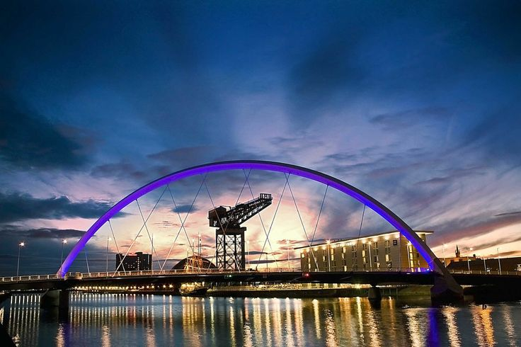 The stunning River Clyde shines like a beacon of light as the Finnieston Crane stands proudly behind our own 'Squinty Bridge'  http://bit.ly/1gjMj3I  #Glasgow #Scotland