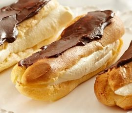 Dark Chocolate Eclairs: Beautifully crisp éclairs filled with whipped vanilla cream and finished with rich dark chocolate. Ideal for afternoon tea or an indulgent chocolate dessert. http://www.bakers-corner.com.au/recipes/desserts/pastry/dark-chocolate-eclairs-2/