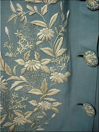 "Trained wool dressing gown / morning dress, 1870s.  Pale China blue wool twill w/ Watteau back, 2-tone embroidery, and ""overcoat"" tailoring in front.  Daisy embroidered buttons & 2 pleated side pockets.  Speechless!"