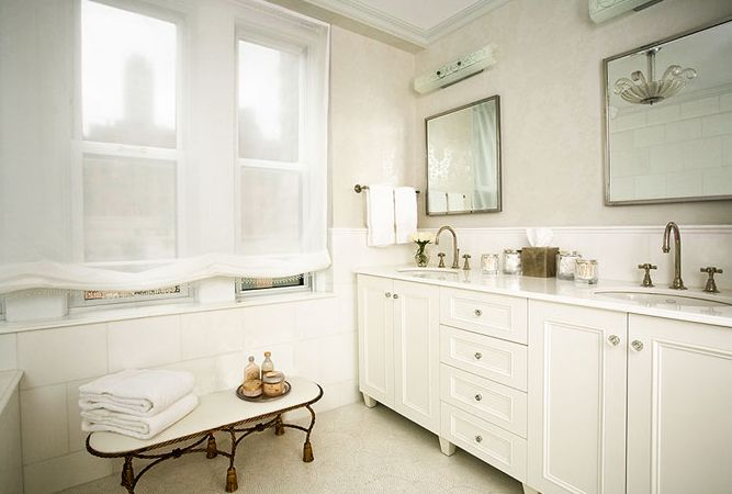 Chic city bathroom design with white bathroom cabinets double sinks, white carrara ...