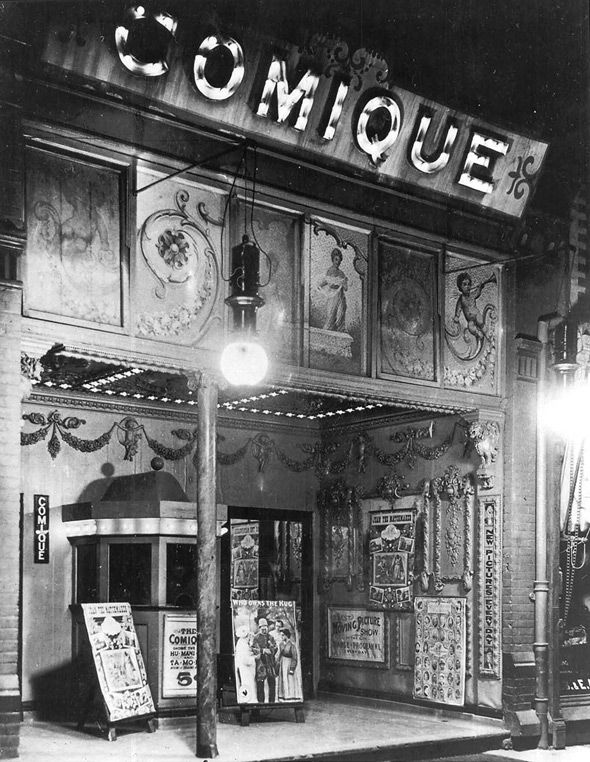 Vintage night-time shot of The Comique Theatre in Toronto, 1910.