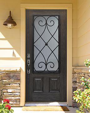 GlassCraft's Artisan premium fiberglass door with Charleston wrought iron design, oak wood grain and ebony finish.