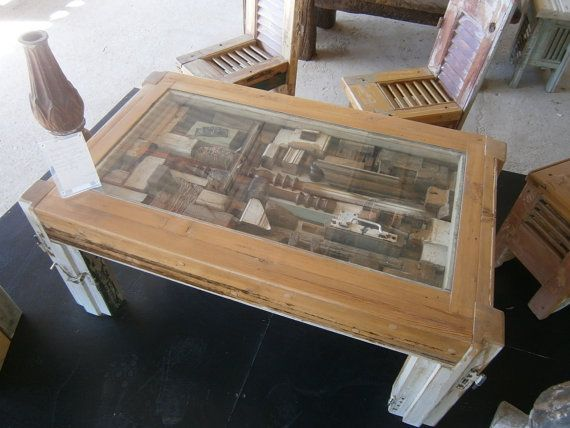 Vintage hand-crafted Coffee Table made from old Reclaimed wooden objects. Under the glass depicts a city view.  102 x 60 x 45  At SIloArtFactory,