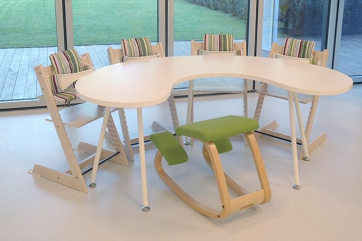 Feeding Table. Kidney shape table for high chairs, that creates a social space where very young children share an adult height table, with place for an adult carer to support with feeding.