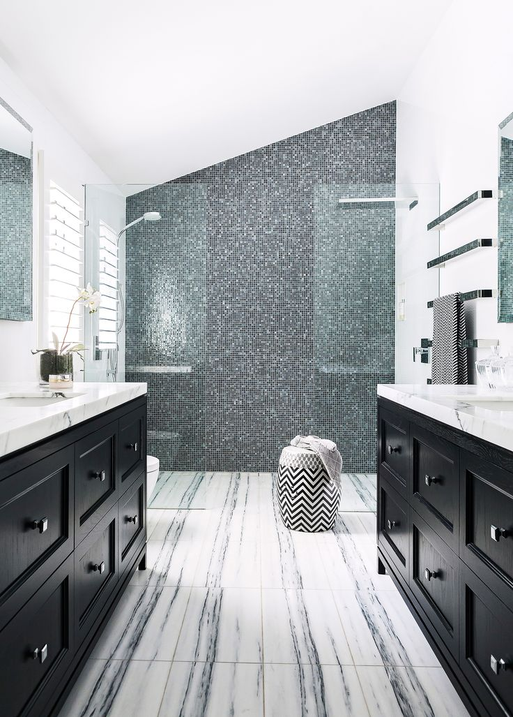 The elegant black-and-white palette of this bathroom is echoed in the Carrara marble floor tiles and sparkling tiled feature wall of Sicis Glass mosaics. Photography: Maree Homer | Stylist: Kate Nixon | Story: Australian House & Garden