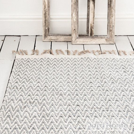 Grey rug, in a chevron geometric pattern, creating laid back Scandi style in your home. Jord Home natural fibre rug in flint grey designed to add depth