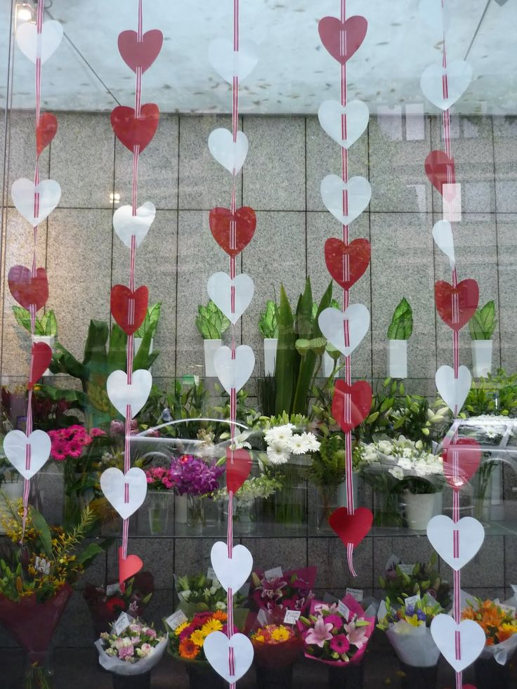 This is an example of a florists window display on Valentines day. It uses hearts, the traditional colours, and shows some things they offer.