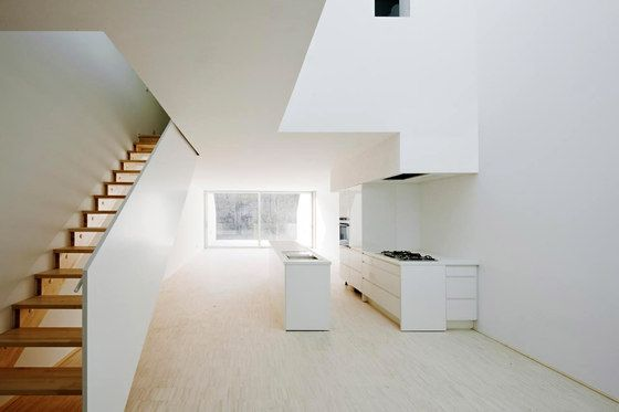wooden open stairs with solid white ballastrade