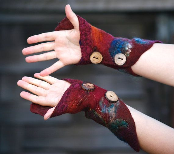 Felt wool and silk two-way cuffs, with a striking color combination; lightweight, they are quite warm on the wrists, and versatile, as they can be worn two ways. Colors of the lace and wool resemble bright sunset, forest , natural and psychedelic hues, with nuno-felted silk chiffon leaf applique and stitching accent on each cuff. Beautiful wooden hand crafted buttons are one of a kind too. Two buttons for each cuff for close fit comfortable wear.    Embellished with lace, silk and mohair…
