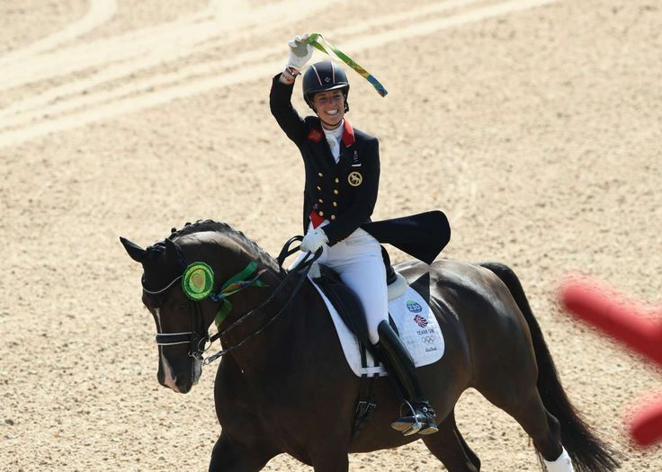 Team GB's Dujardin wins third Olympic gold: Charlotte Dujardin of Great Britain riding Valegro celebrates after winning the gold medal during the individual dressage grand prix freestyle. - 2016 Rio Olympics: Highs and lows from Day 10