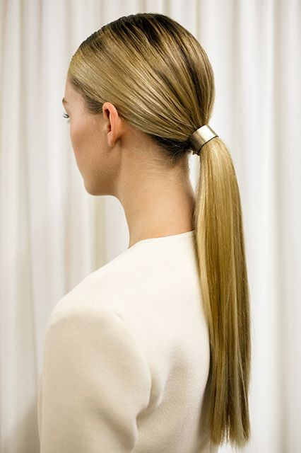 Runway Hair You'll Actually Want To Wear #refinery29  http://www.refinery29.com/2014/09/74304/best-hairstyles-fashion-week-spring-2015#slide5  Metallic Accents  Still trending: hair accessories. James Pecis secured cuffs around the sleek ponytails at Wes Gordon to mimic the metallic effects in the designer's collection. Redheads and blondes, take note: Gold and rose gold ponytail holders are a gorgeous way to make your color pop.