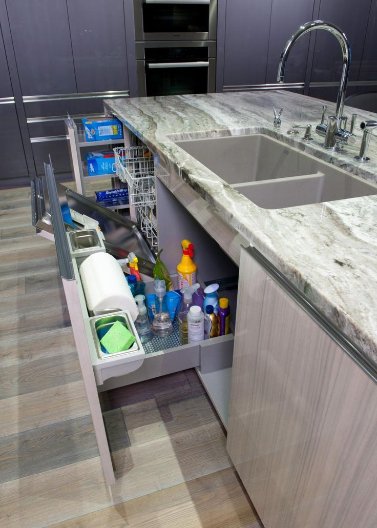 A roll-out drawer under the sink is the perfect spot to stash cleaning supplies, while a slim pull-out cabinet holds plastic wrap and aluminum foil. When closed, the dishwasher is concealed with the same sleek finish as the rest of the island.