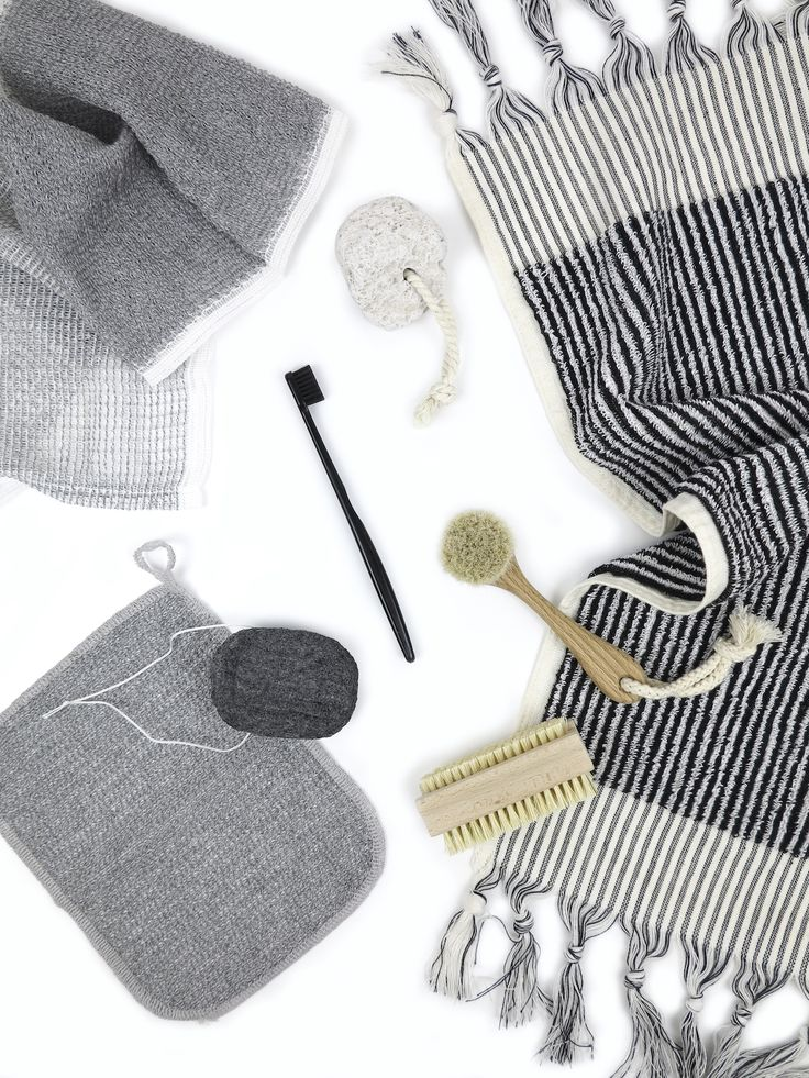 Natural personal care brushes - binchotan charcoal, organic turkish cotton towel, pumice stone. Available from www.paperplanestore.com