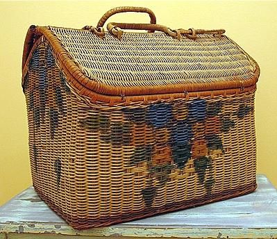 painted 'basket' suitcase...  I have one, but it is green and pink.. My mother in-law bought it for me years ago!