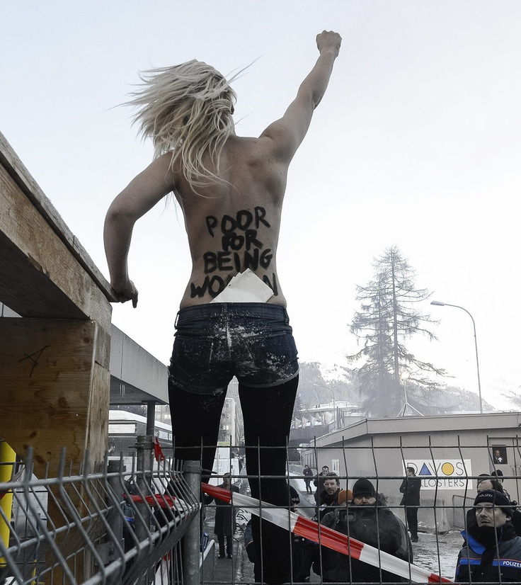 Femen Protests The World Economic Forum An activist of the Ukrainian feminist group FEMEN stands on a fence during a protest at the 43rd Annual Meeting of the World Economic Forum, WEF, in Davos, Switzerland, Saturday, Jan. 26, 2013.